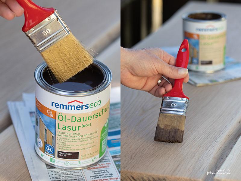 Gartentisch mit einem Pinsel und Farbe anstreichen mit meinestube