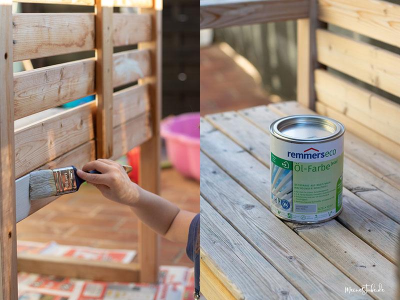 Tochter streicht Sitzbank mit Farbe an, mit meinestube